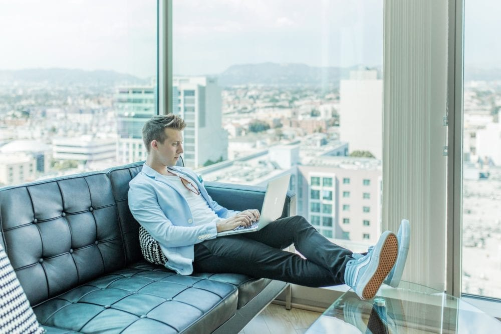 man on laptop hiring a freelance contractor