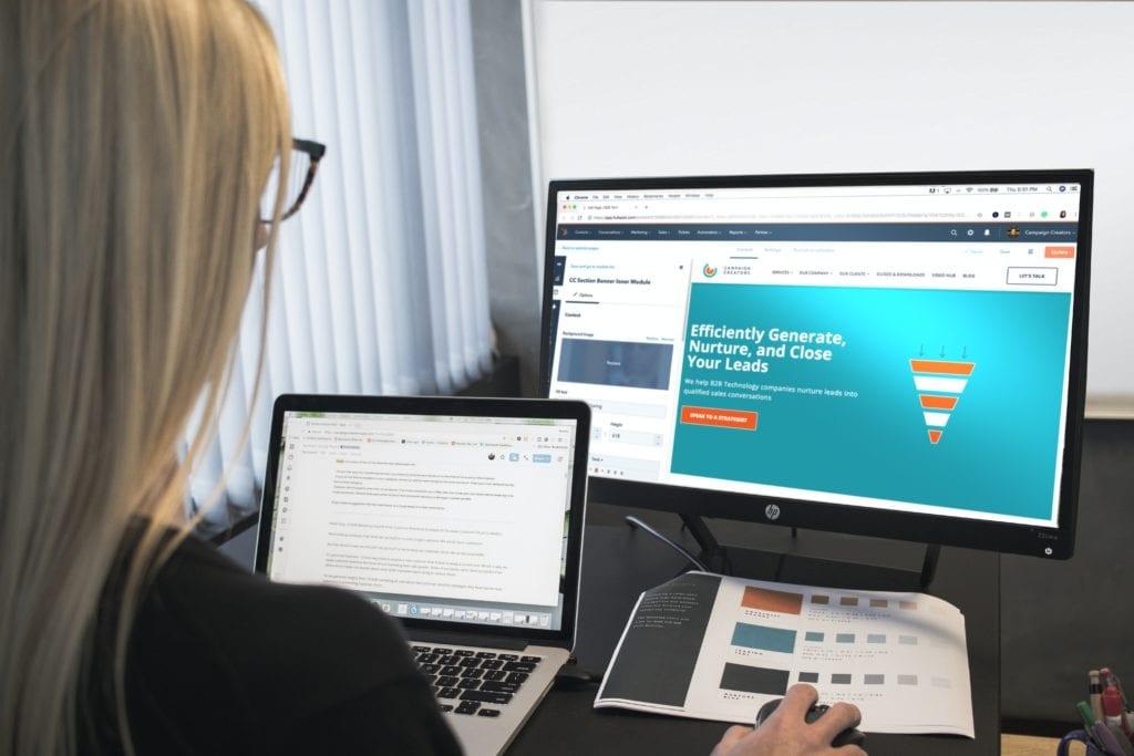 Woman using HubSpot on computer